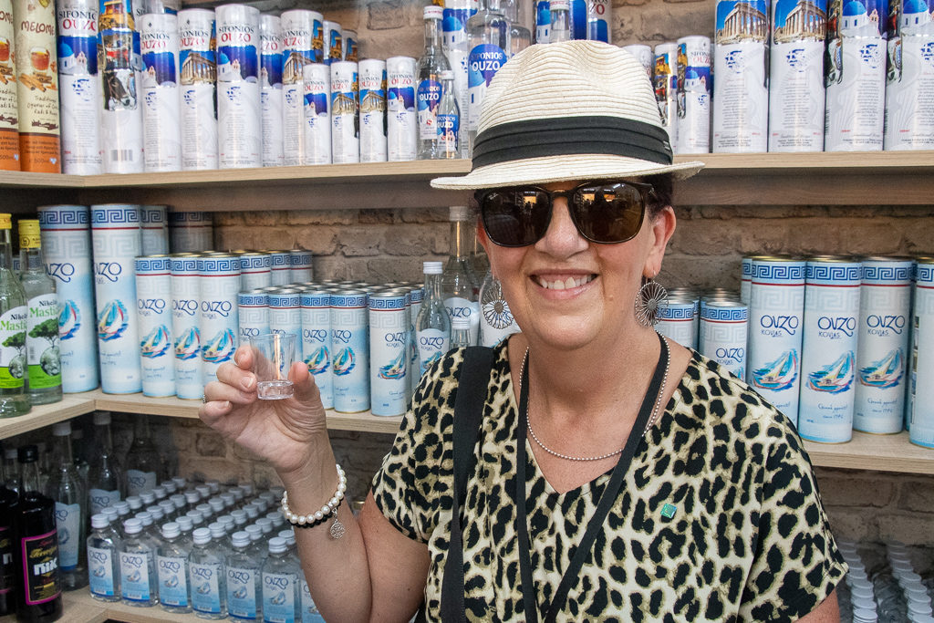Merrisa checks out the Ouzo in  Olympia